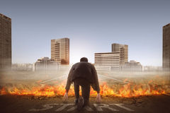 Back view of man start running through broken road. Back view of asian business man start running over broken road with fire Royalty Free Stock Images