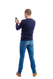 Back view of man in suit  talking on mobile phone. Stock Photos