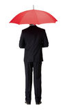Back view of man in suit with umbrella. Back view of man in suit with opened red umbrella, isolated on white Stock Image