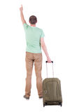 Back view of  man  with suitcase. Stock Image