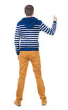 Back view of  man in sweater shows thumbs up. Royalty Free Stock Image