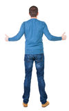 Back view of  man in sweater shows thumbs up. Stock Image