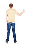 Back view of  man in t-shirt. shows thumbs up. Royalty Free Stock Photography