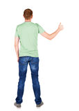 Back view of  man in t-shirt. shows thumbs up. Stock Photography