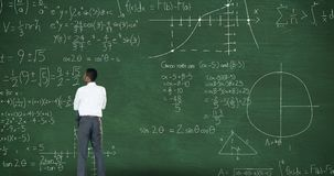 Back view of man thinking in front of moving maths calculations on chalkboard