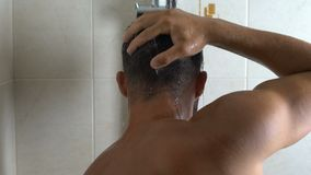 Back view of man thoroughly washing greasy hair, suffering from dandruff. Stock footage stock video