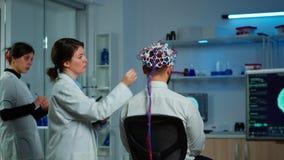 Back view of man wearing performant brainwave scanning headset