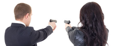Back view of man and woman shooting with guns isolated on white Stock Photos