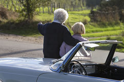 Back view of Mature couple by car in countryside Royalty Free Stock Images