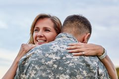 Back view, mature soldier is hugging with his wife. royalty free stock photos