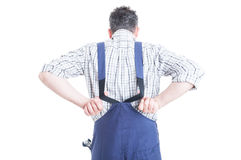 Back view of mechanic wearing blue overalls for work protection Royalty Free Stock Image