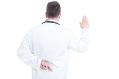 Back view of medic or doctor lying about Hippocratic oath Royalty Free Stock Images