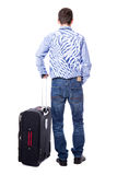 Back view of middle aged business man standing with suitcase iso Stock Image