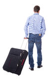 Back view of middle aged business man walking with suitcase isol Royalty Free Stock Photography