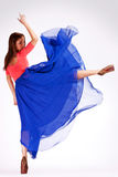 Back view of a modern ballerina kicking royalty free stock photo