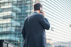 Back view of modern businessman in the city stock images