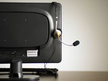 Back view of the monitor with an ear piece Stock Photos