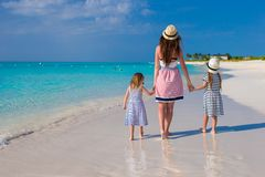 Back view of mother and little daughters enjoy Royalty Free Stock Photo