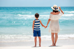 Back view of mother and son at Thai beach Stock Images
