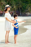 Back view of mother and son at Thai beach Royalty Free Stock Image