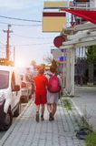 Back view of mother and son, who travel in city. stock photos
