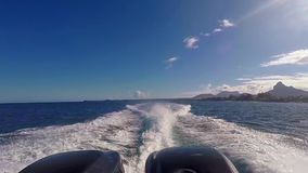 Back view of motor boat near coast in Mauritius. With blue sky and beautiful landscape stock footage