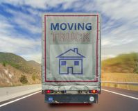 Back view of moving truck transport container on the high way road Stock Photo