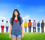 Back View of Multiethnic People and Cheerful Woman Royalty Free Stock Photo