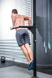 Back view of muscular man exercising with bars Royalty Free Stock Photo