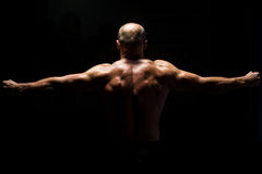 Back View OF A Muscular Man Praying Royalty Free Stock Images
