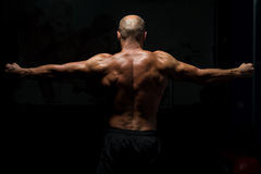 Back View OF A Muscular Man Praying Stock Images