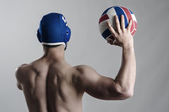 Back view of muscular water polo player holding and shooting ball Royalty Free Stock Photography
