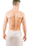 Back view of a muscular young man. Wearing a towel Stock Photography