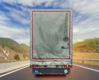 Back view of music truck cargo transport container on the high road Stock Images