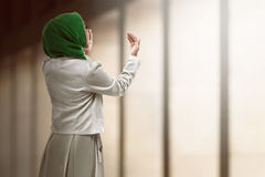 Back view of muslim woman praying. Wearing hijab Royalty Free Stock Images