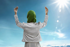 Back view of muslim woman praying. Wearing hijab Royalty Free Stock Photo