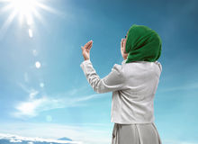 Back view of muslim woman praying. Wearing hijab Stock Photos