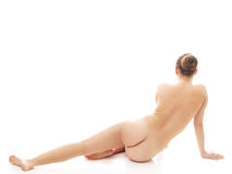 Back view of nude woman sitting on the floor Royalty Free Stock Photo