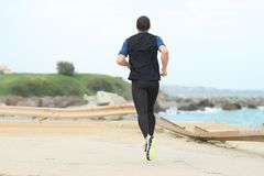 Free Back View Of A Runner Running Alone On The Beach Royalty Free Stock Image - 159271926