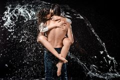Back View Of Sexy Young Couple Swilled With Water Stock Photos