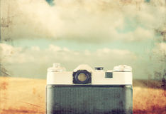 Back view of old camera in front sea. vintage filtered image. Stock Photography