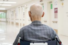 Old man sitting on wheelchair in hospital stock photography