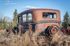 Back view of an old rusty model T car. Royalty Free Stock Photos