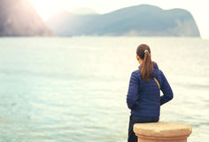 Back view of one teenager girl thinking alone and watching the sea Royalty Free Stock Images
