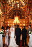 Back view of orthodox bride, groom, godfather and godmother in church Royalty Free Stock Photo