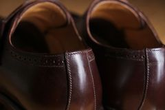 Back view of a pair of classic brown leather Brogue shoes Royalty Free Stock Photos