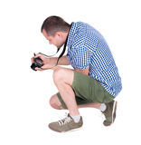 Back view of photographing man. Royalty Free Stock Photo