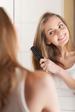 Back view picture of beautiful woman with comb. Stock Image