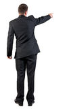 Back view of pointing business man. Stock Photos
