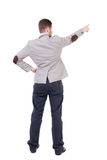 Back view of pointing business man. Royalty Free Stock Photo